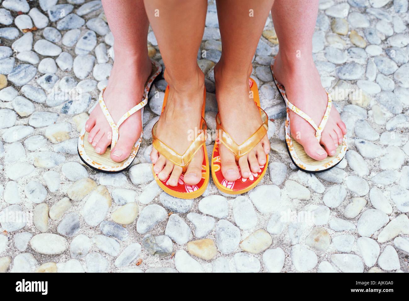 Feet in flip flops Stock Photo