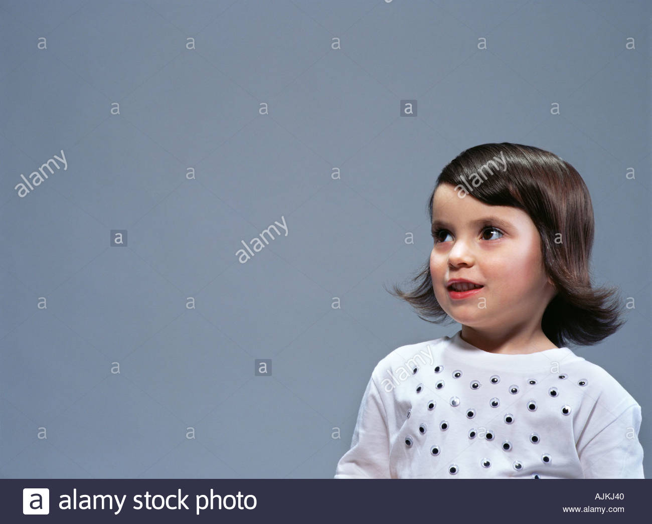 Girl with plastic eyes on her t-shirt - Stock Image