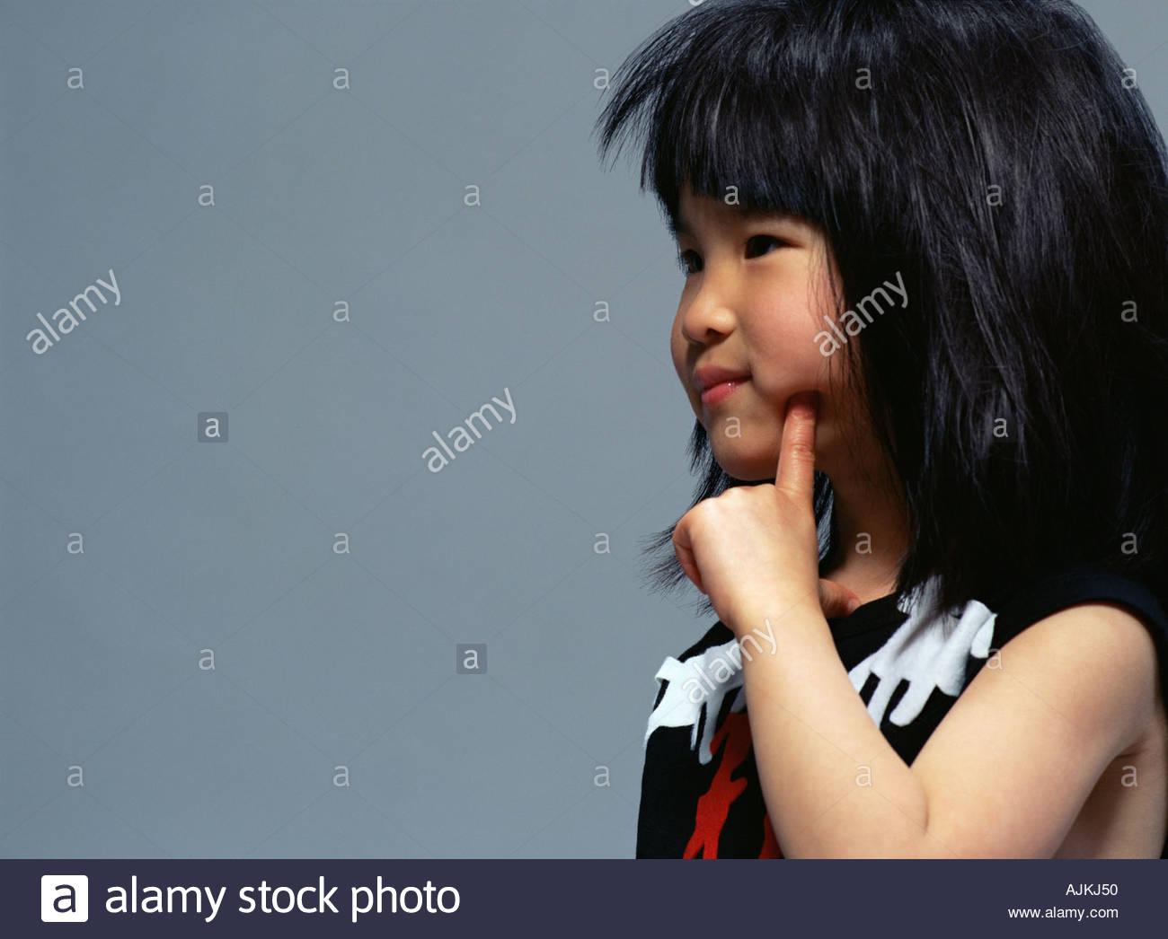 Girl thinking - Stock Image