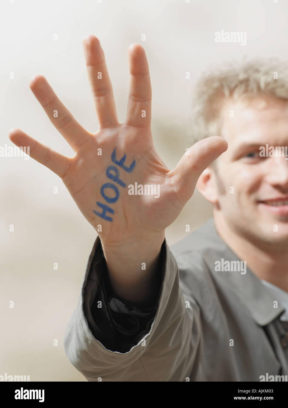 Man with hope written on his hand - Stock Image