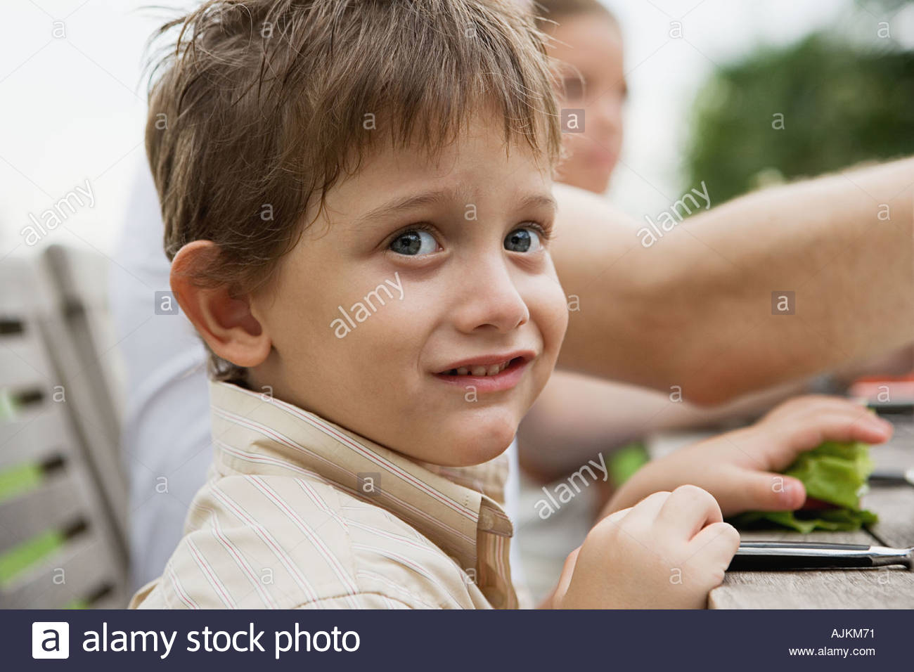 Boy making a face - Stock Image
