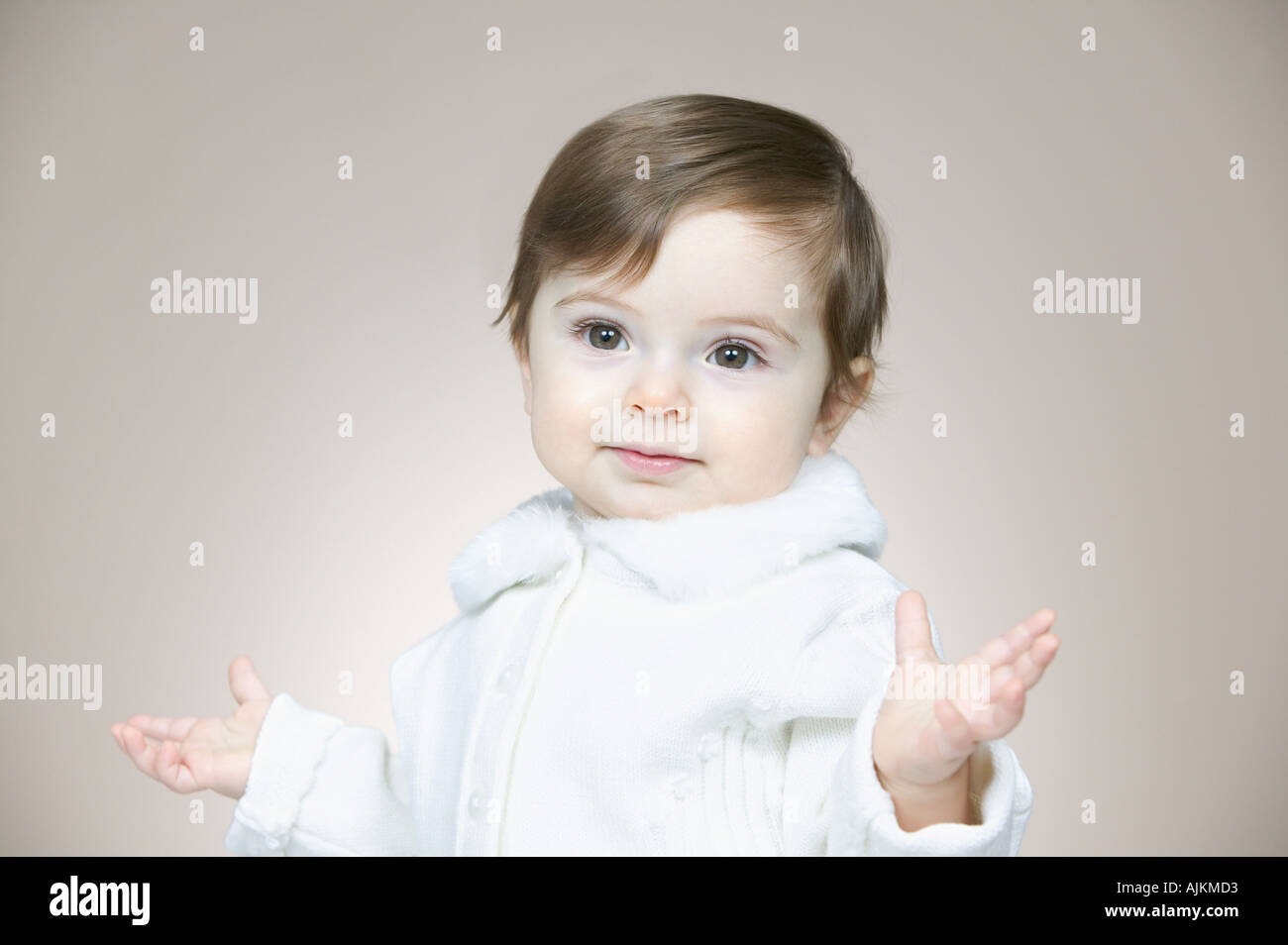 Innocent looking baby girl - Stock Image
