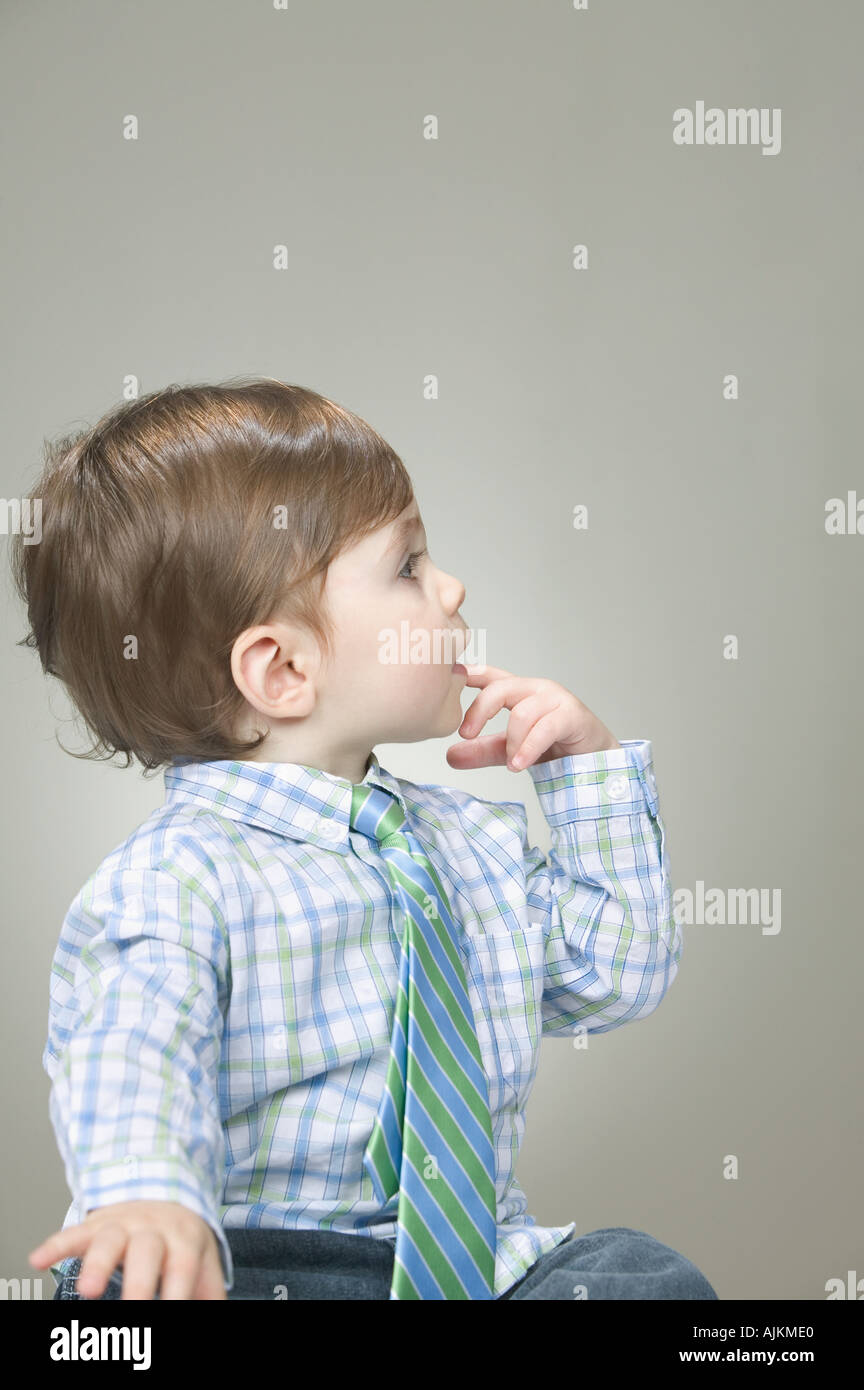 Baby wearing a shirt and necktie - Stock Image