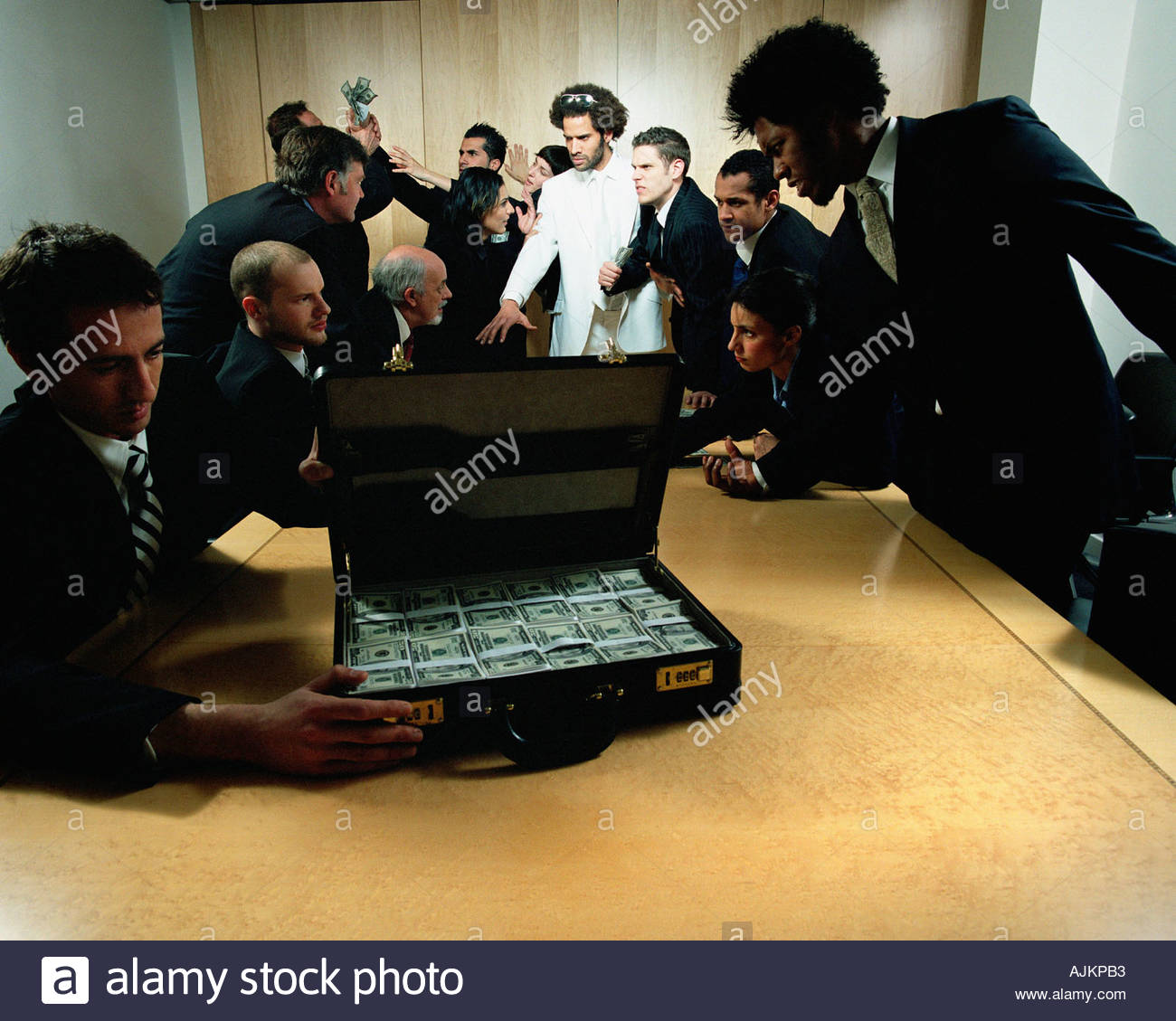 Businessmen with suitcase full of money Stock Photo
