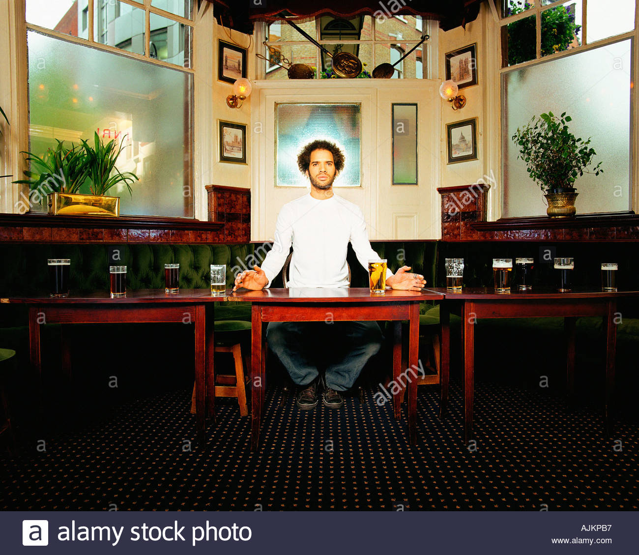 Man with halo in pub - Stock Image
