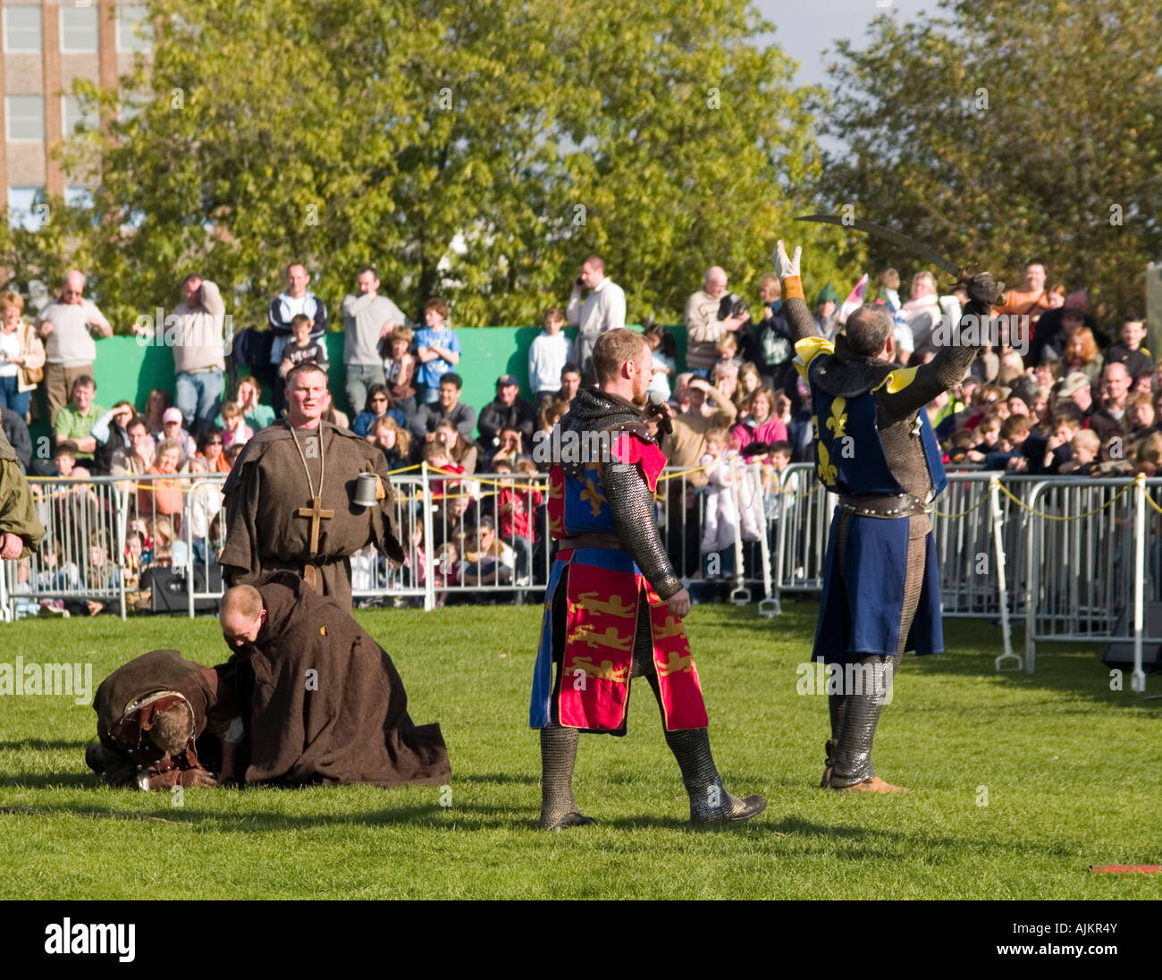 The Sheriff of Nottingham claims victory after a battle with Robin Hood at the Robin Hood Pageant, Nottingham Castle - Stock Image