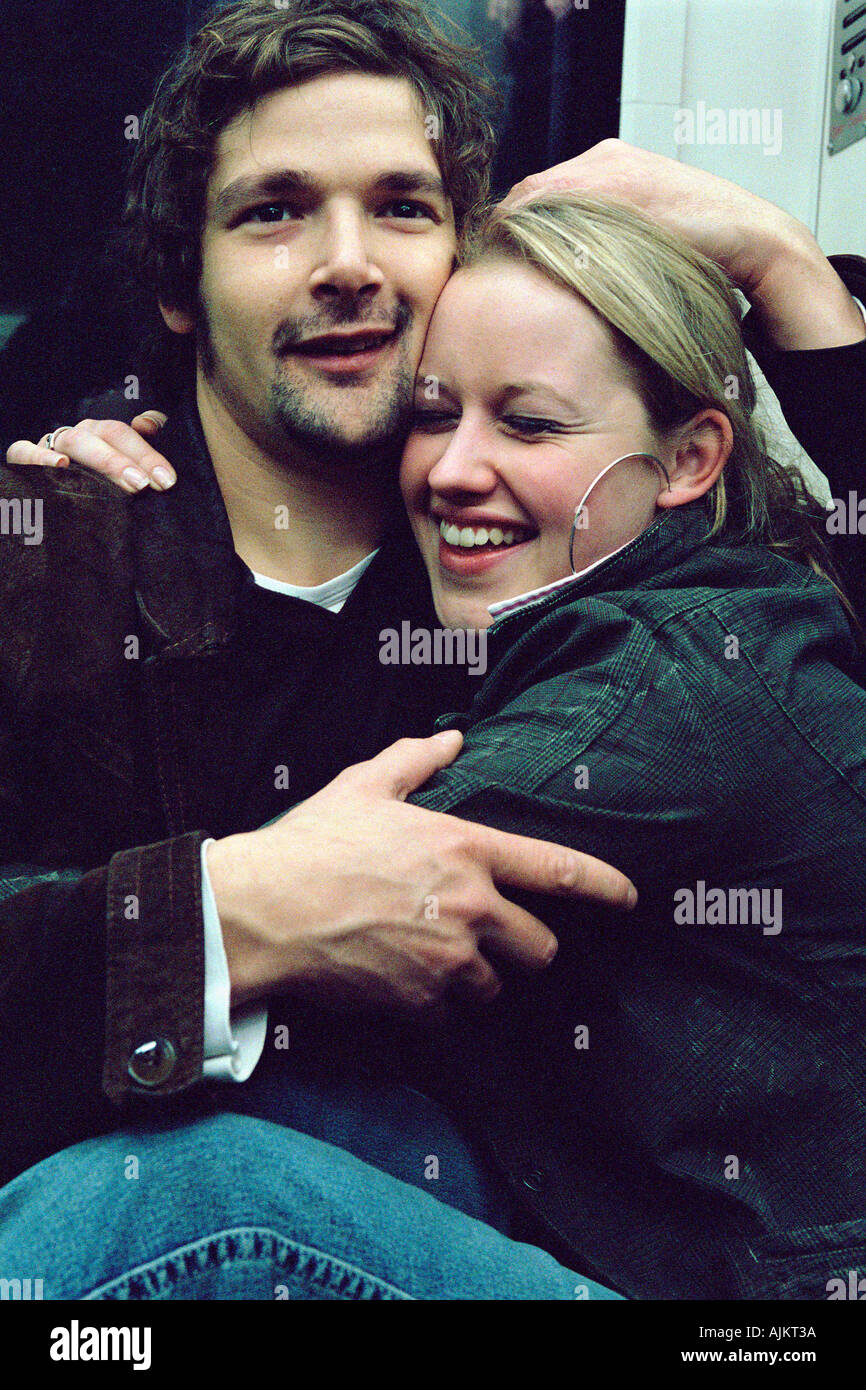 Couple hugging on subway train - Stock Image