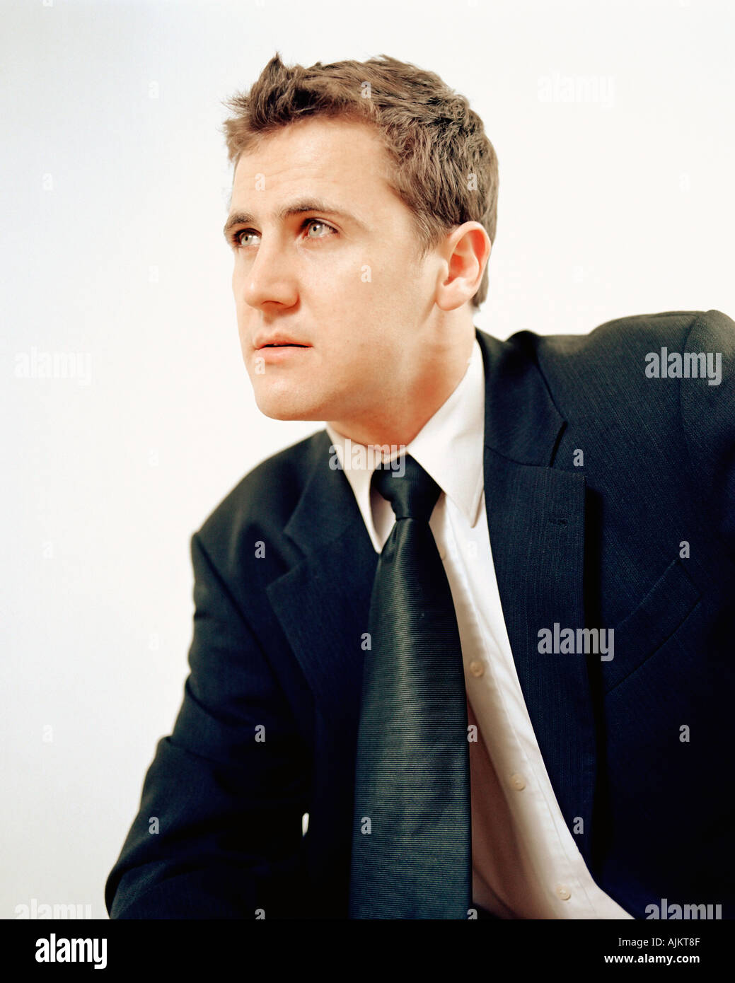 Man in suit poses theatrically - Stock Image