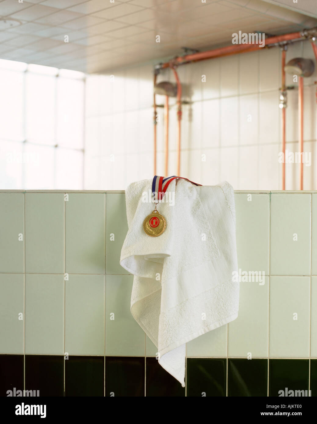 Medal and towel on wall - Stock Image