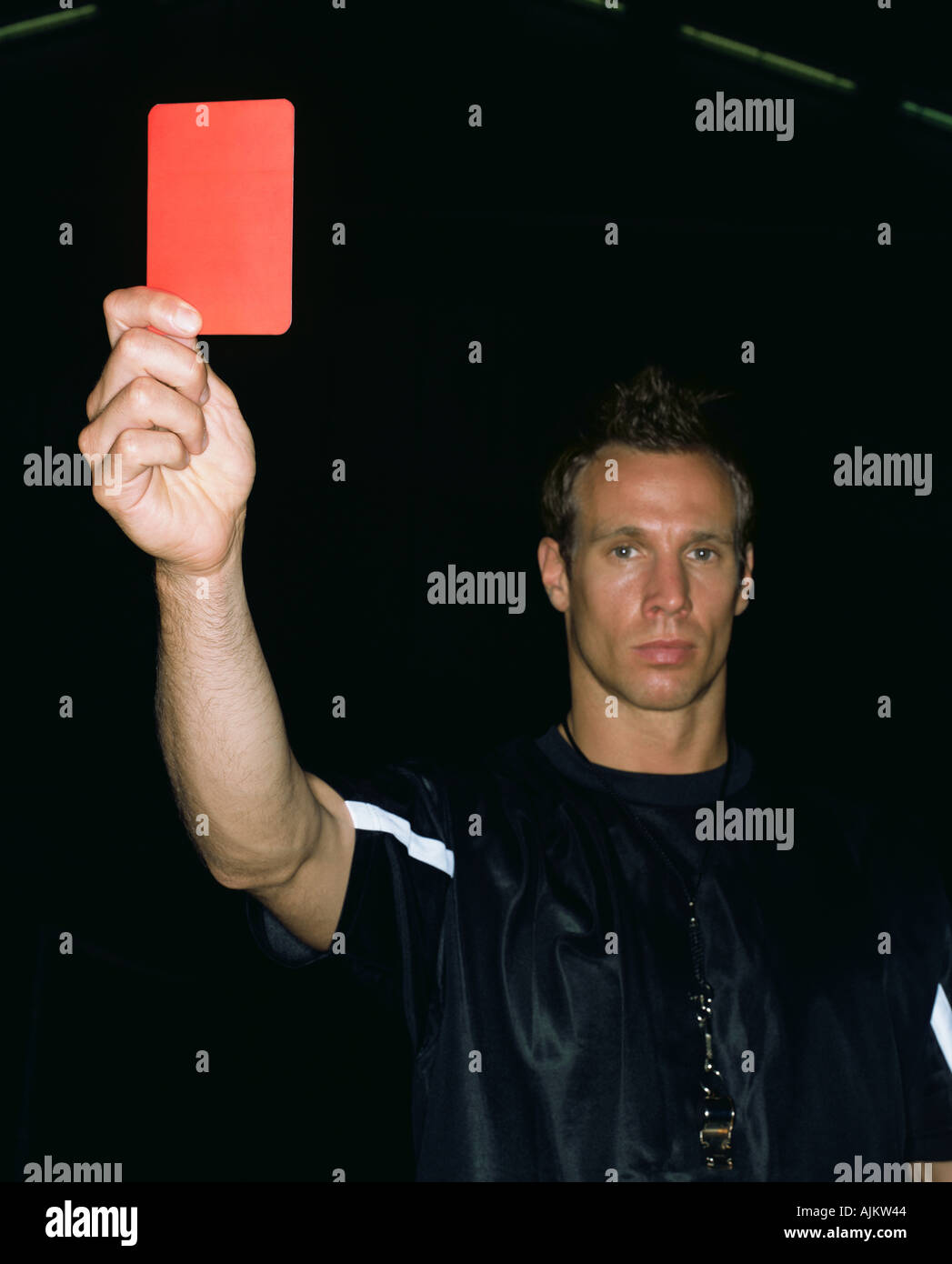 Referee holding a red card - Stock Image