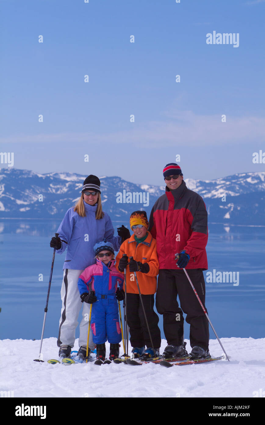A family posing for a skiing portrait at Daimond Peak NV - Stock Image