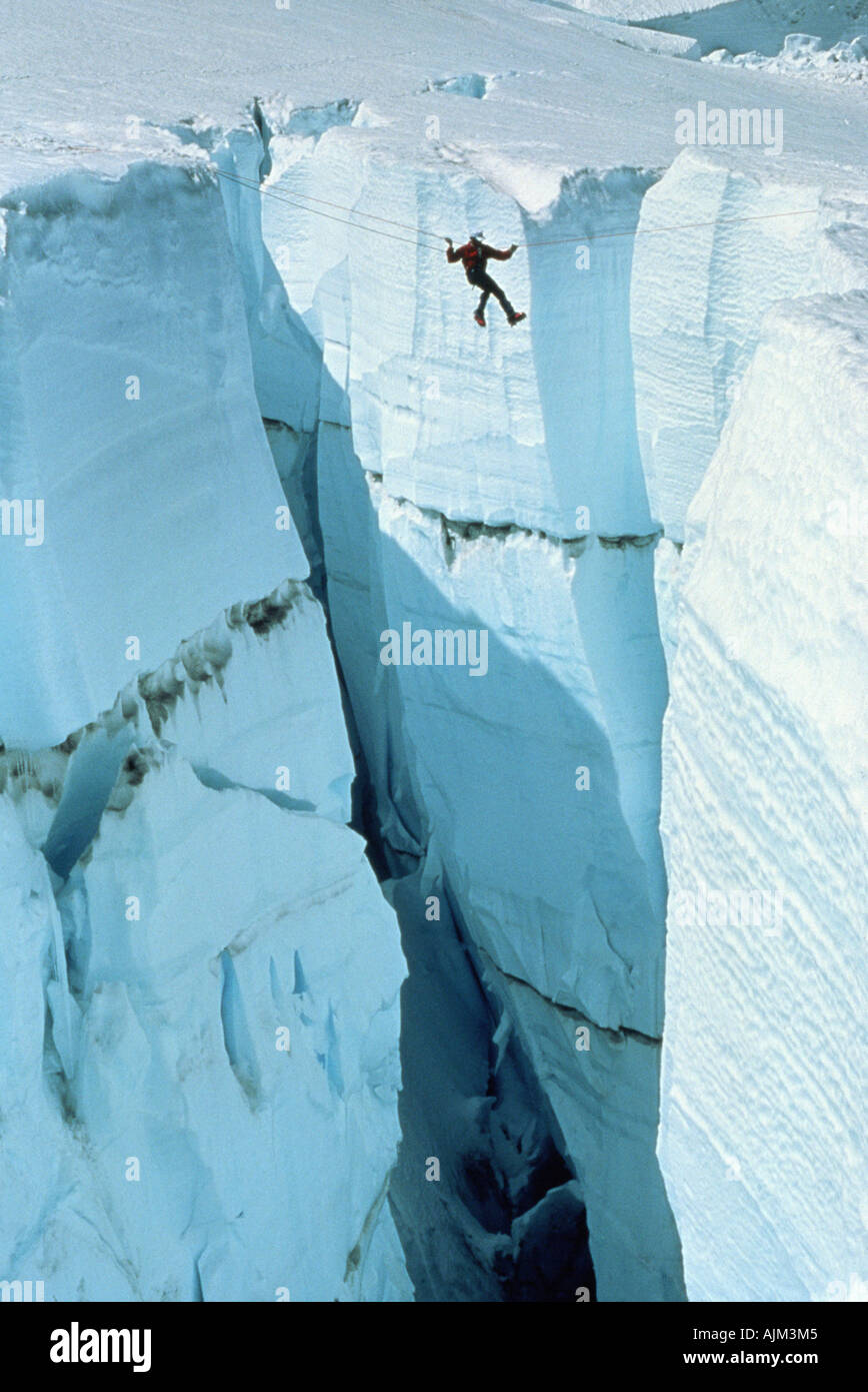 Executing a Tyrolean Traverse on the Ingraham Glacier on the side of Mt Rainier Washington - Stock Image