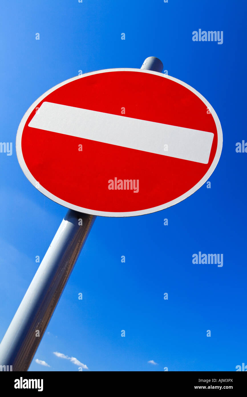 Road sign in a British town to inform drivers of no entry to a street it is a red circle with white horizontal stripe - Stock Image