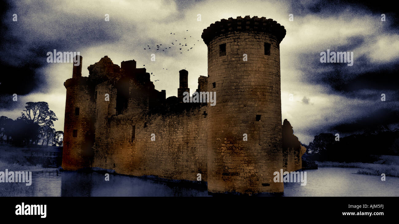caerlaverock castle dumfrieshire looking moody with crows up above - Stock Image