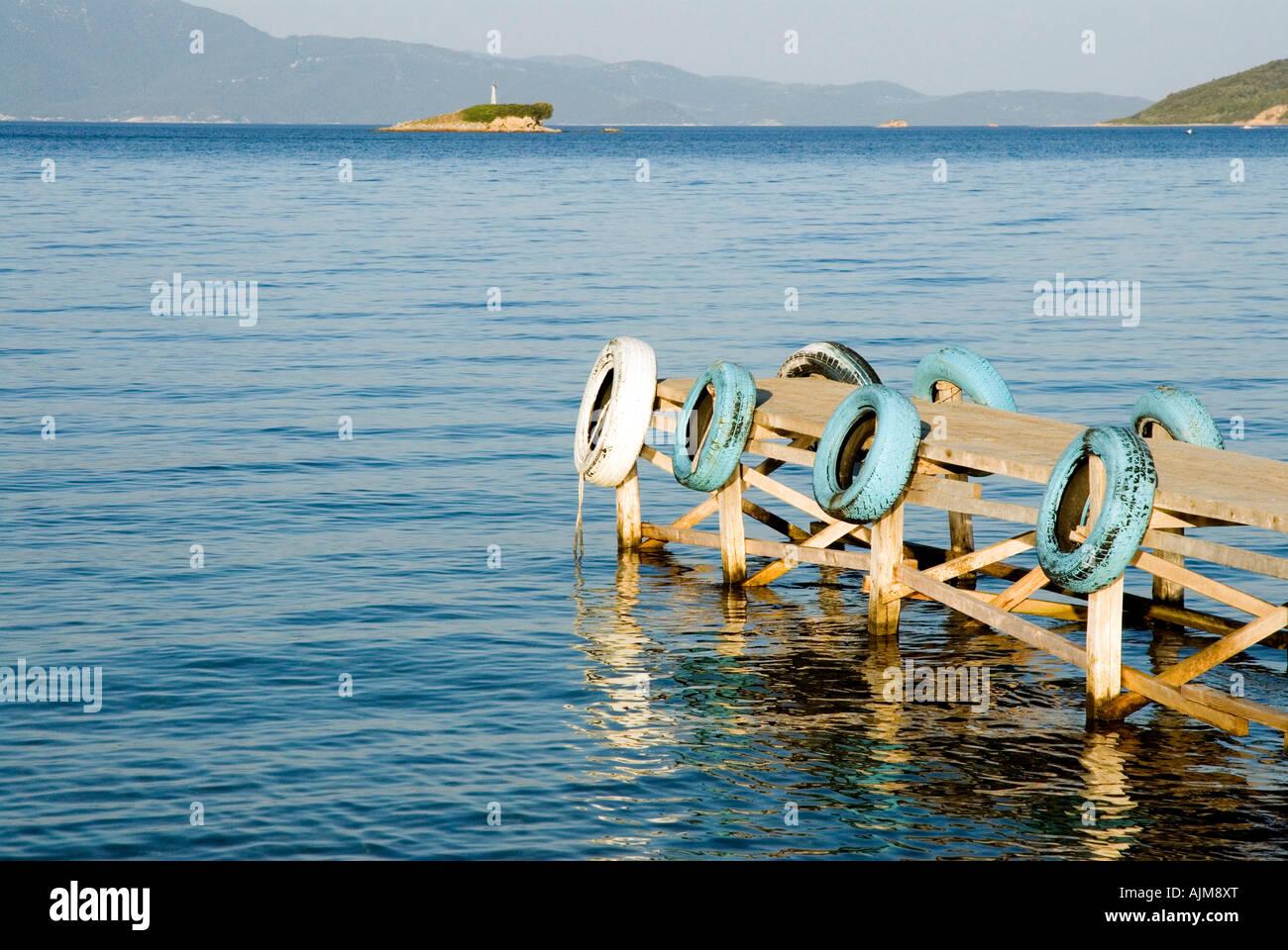 Ferry jetty Tzaneria Nostos beach Kalamaki peninsula Skiathos Island Sporades Aegean Sea Mediterranean Greece - Stock Image