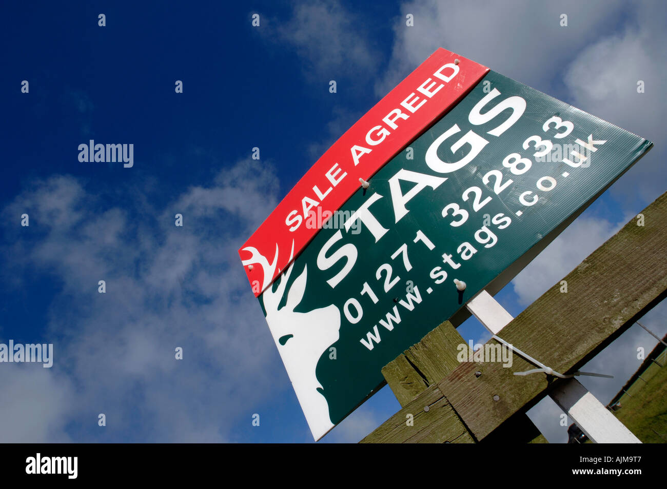 A property for sale agreed sign on a country road in rural Devon - Stock Image