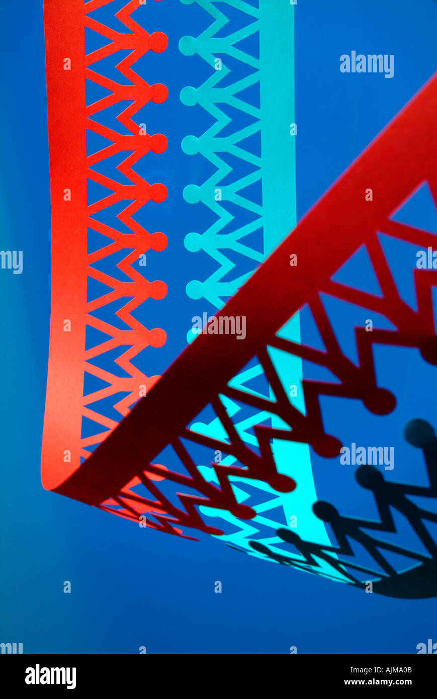 Paper chain peole as dna double helix - Stock Image
