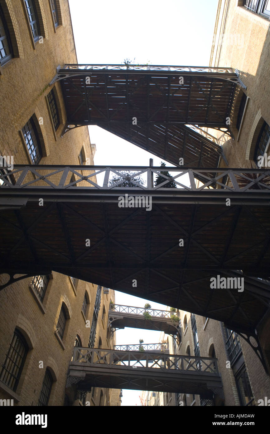 Bridge link restores warehouse apartments butlers wharf shad thames southwark london SE1 - Stock Image