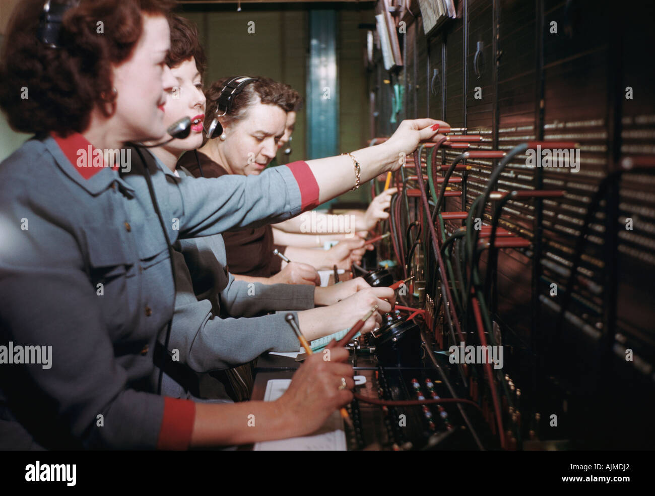 Telephone operator switchboard 1950s - Stock Image