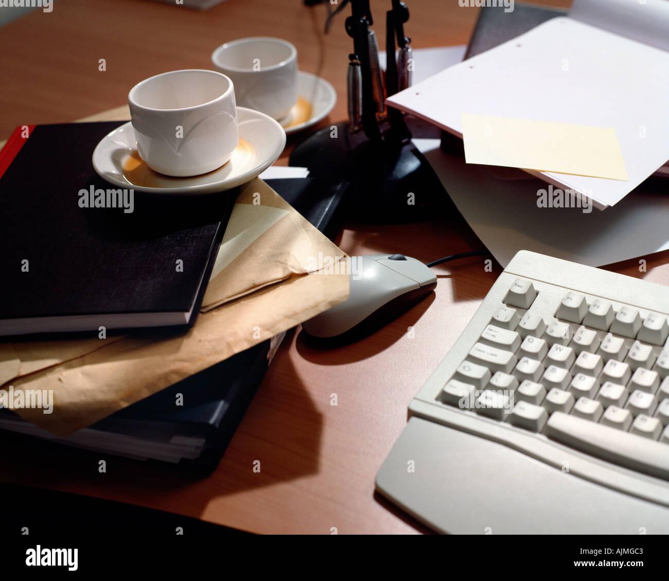 Messy desk - Stock Image