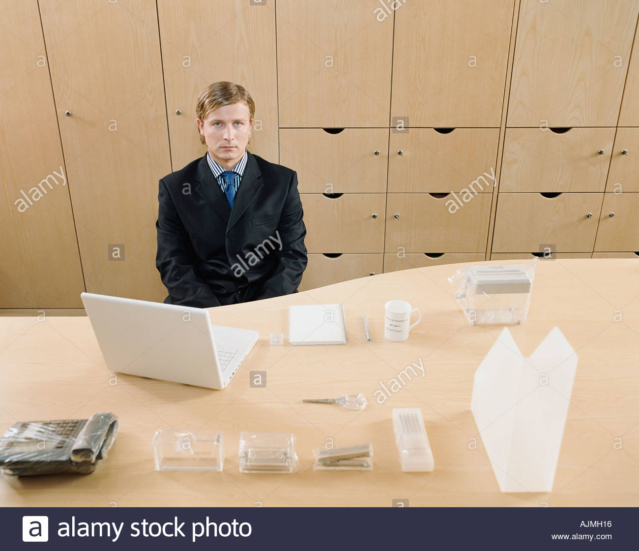 Obsessively tidy businessman - Stock Image