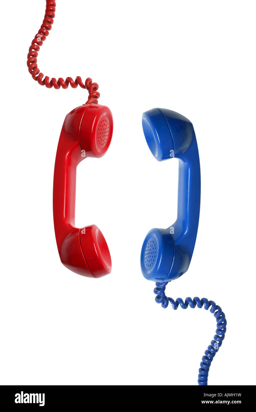 Red and Blue telephone receivers cut out on white background - Stock Image