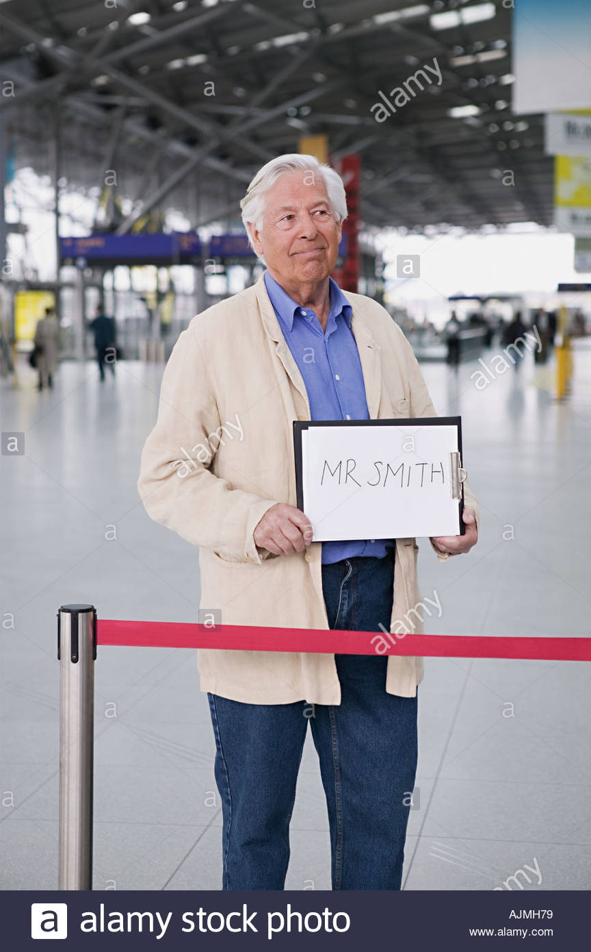 Man waiting in airport - Stock Image