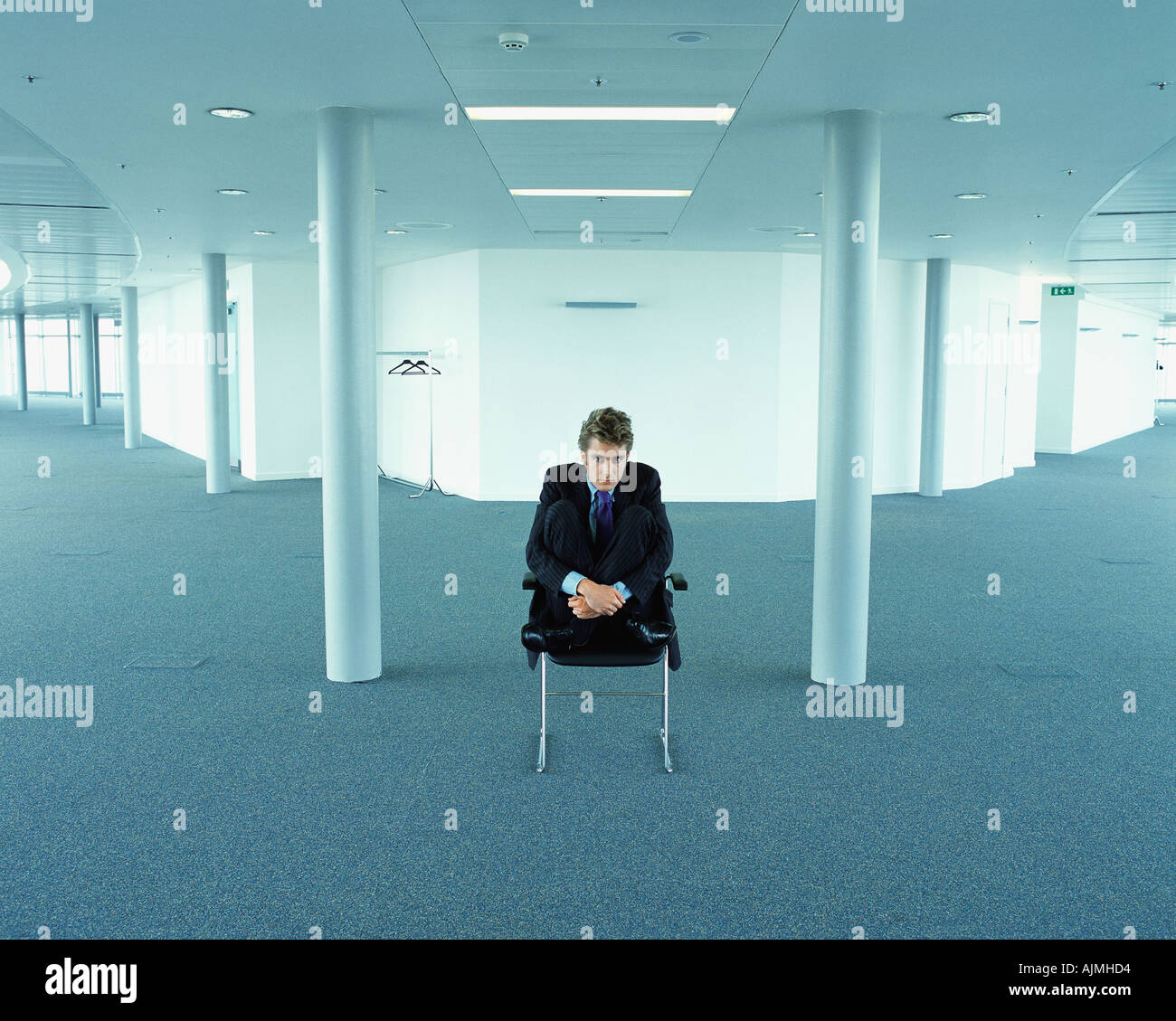 Scared looking businessman - Stock Image