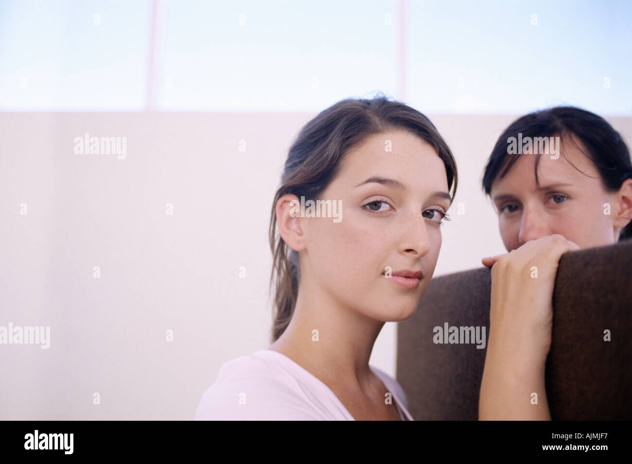 Two women chatting over divider - Stock Image