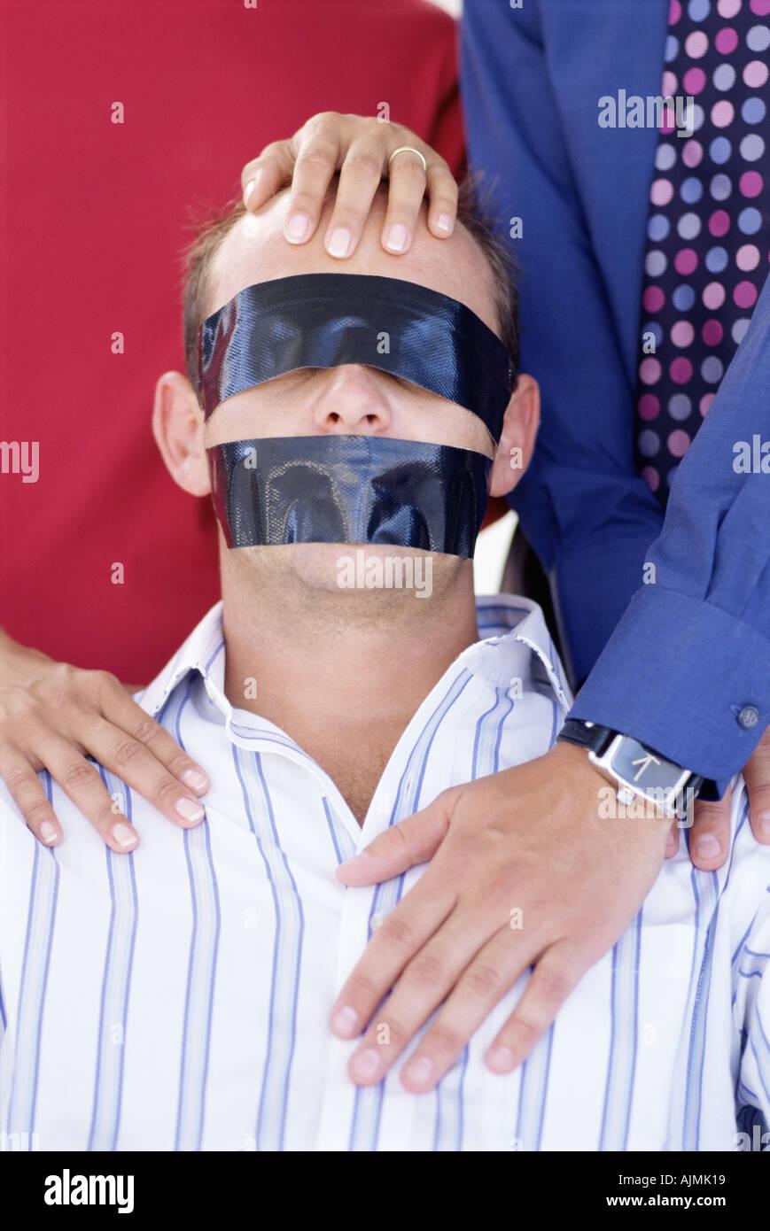 Office worker taken hostage - Stock Image