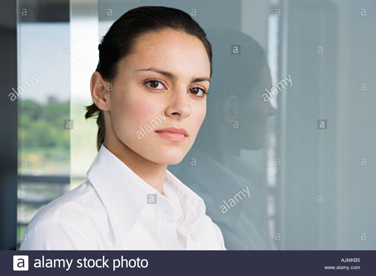 Young woman in a white shirt - Stock Image