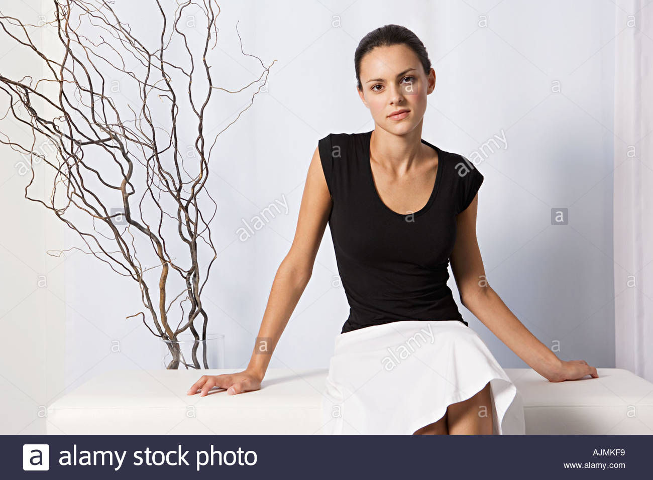 Young woman in black and white - Stock Image