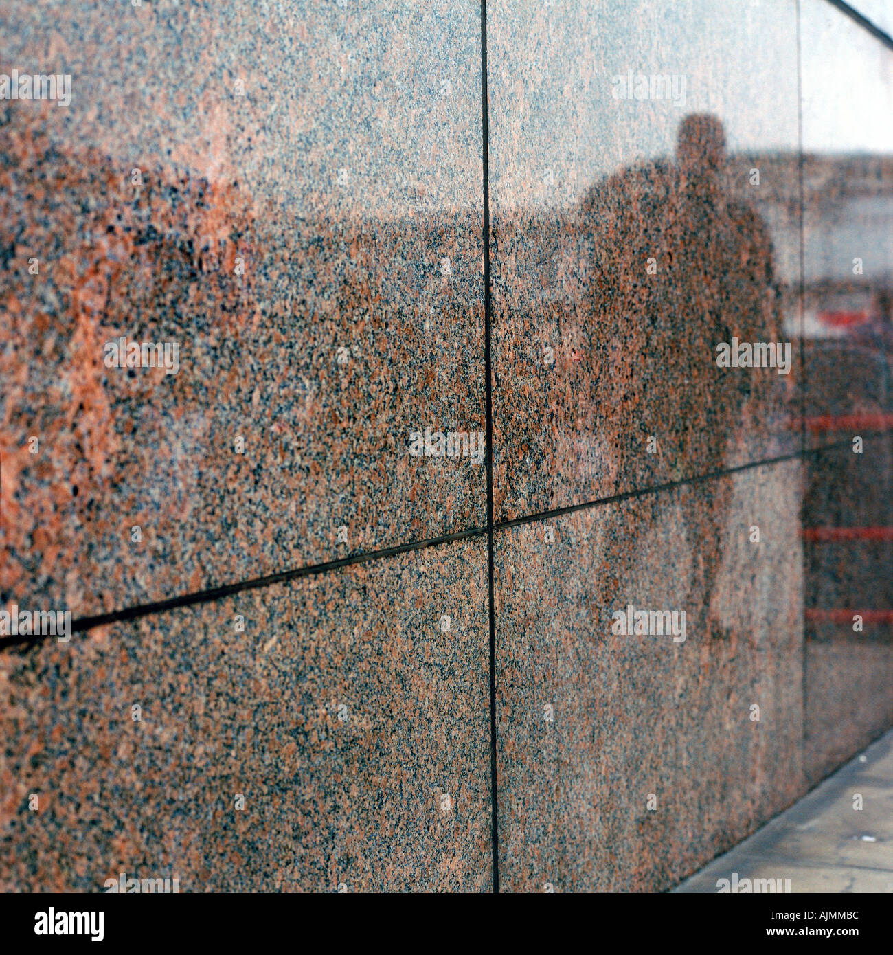 Man reflected on wall tile - Stock Image