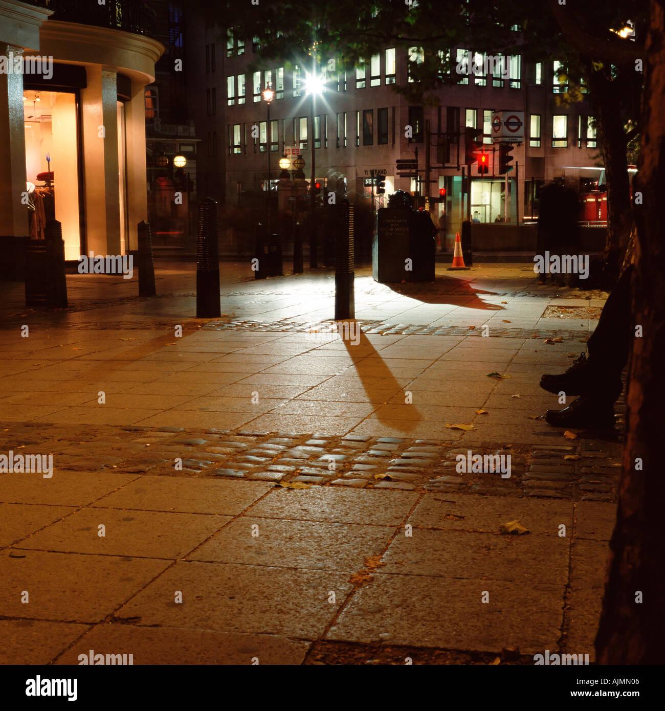 Illuminated street at night - Stock Image