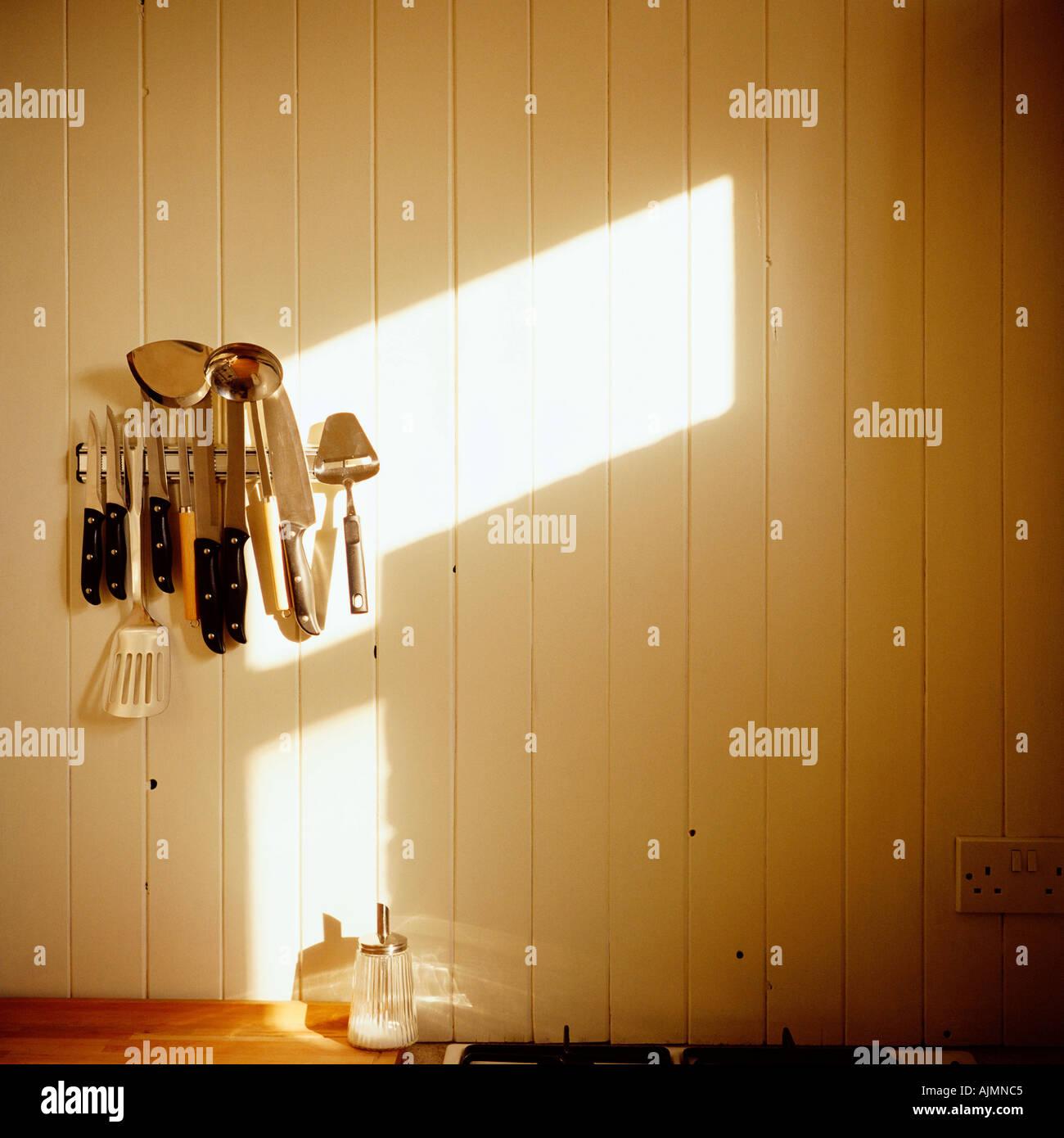 Kitchen utensils on wall - Stock Image