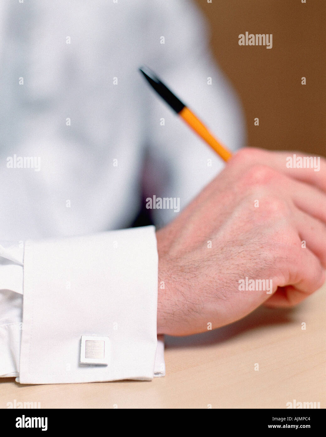 Man wearing a square cuff link - Stock Image