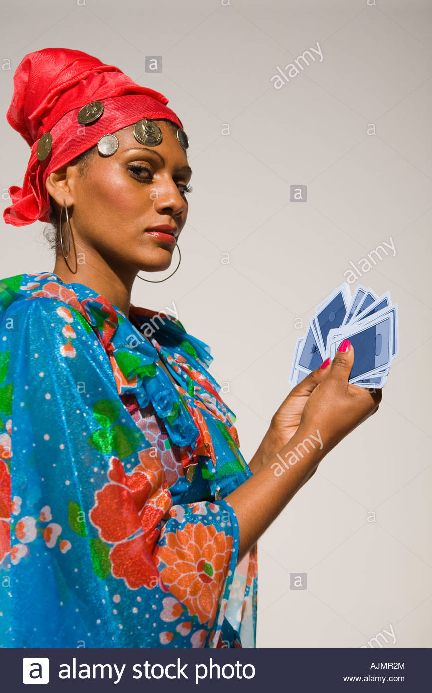 Portrait of a young woman showing tarot cards - Stock Image