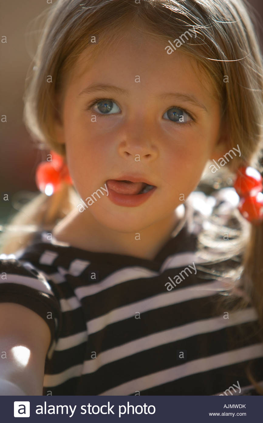 Close-up of a girl sticking her tongue out Stock Photo
