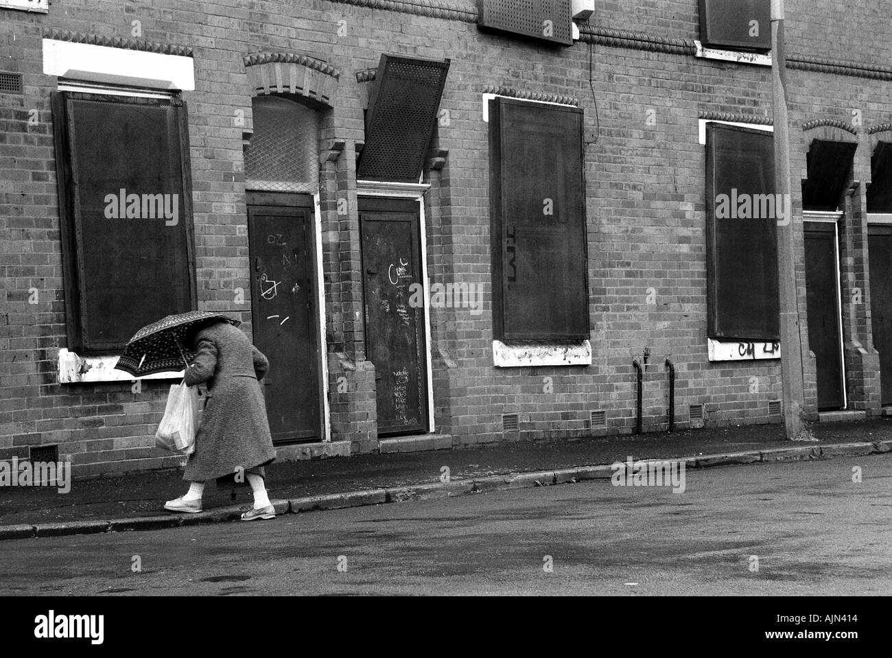 older woman in inner city poverty - Stock Image