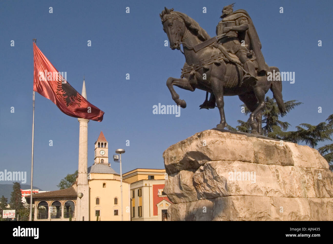Skanderbeg Statue Albanian flag and Et hem Bey mosque Tirana Albania - Stock Image
