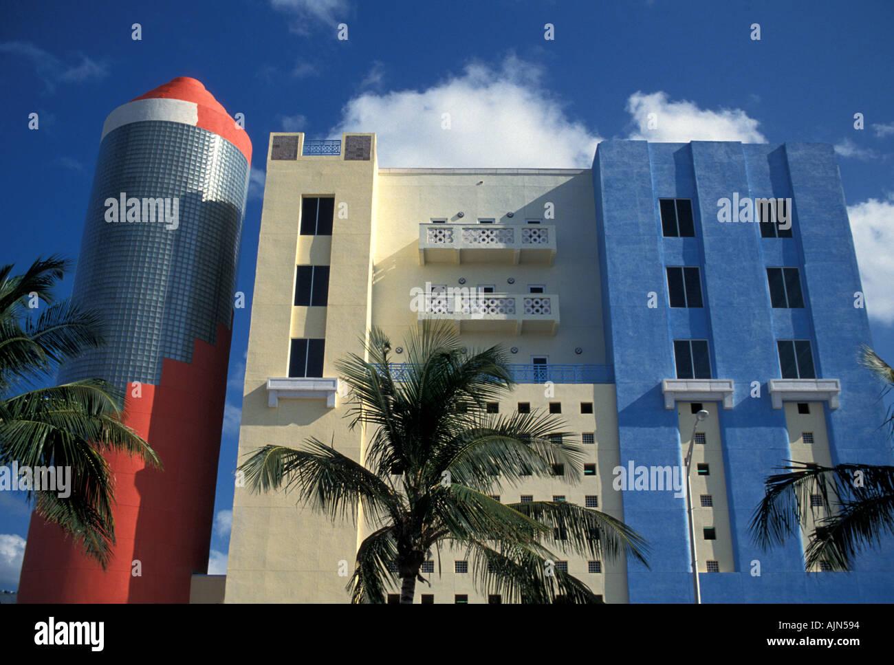 Florida Miami South Beach Art Deco Building Red Blue Palm Trees - Stock Image