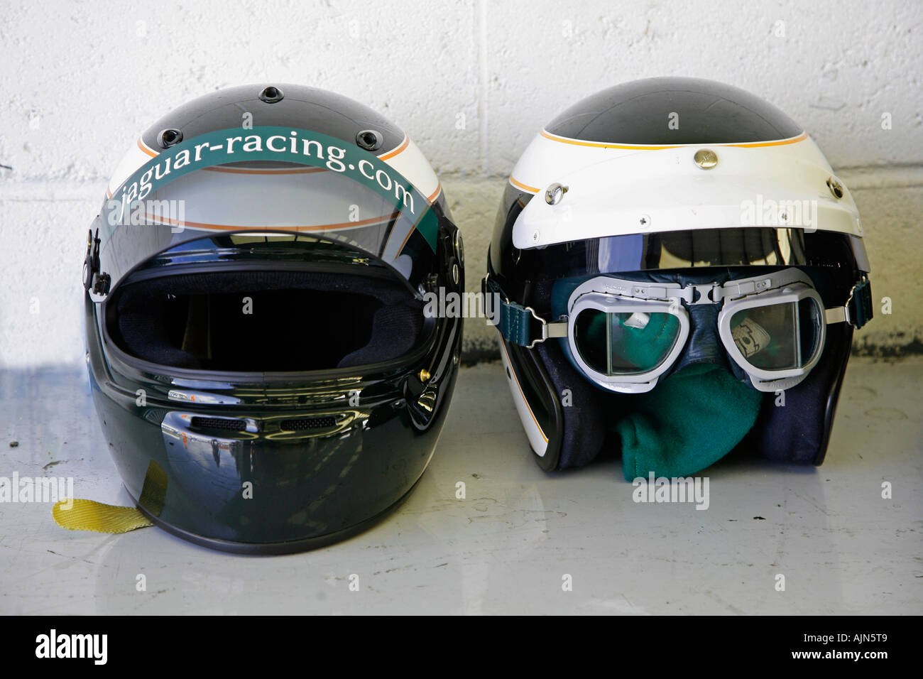 Two Racing Helmets And Goggles On The Pit Garage Floor At A Vintage Motor Race Circuit Meeting 2006