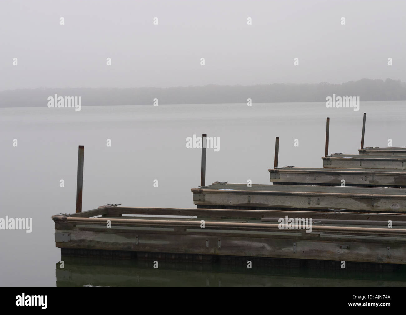 Boat dock in the Fog - Stock Image
