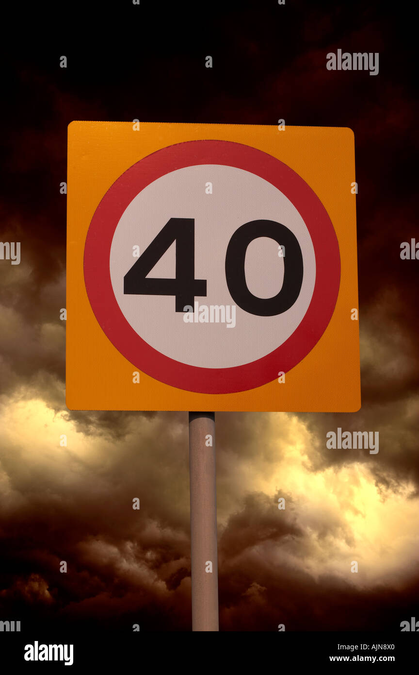 FORTY MILE AN HOUR ROAD SPEED LIMIT SIGN WITH STORMY SKY BACKGROUND - Stock Image