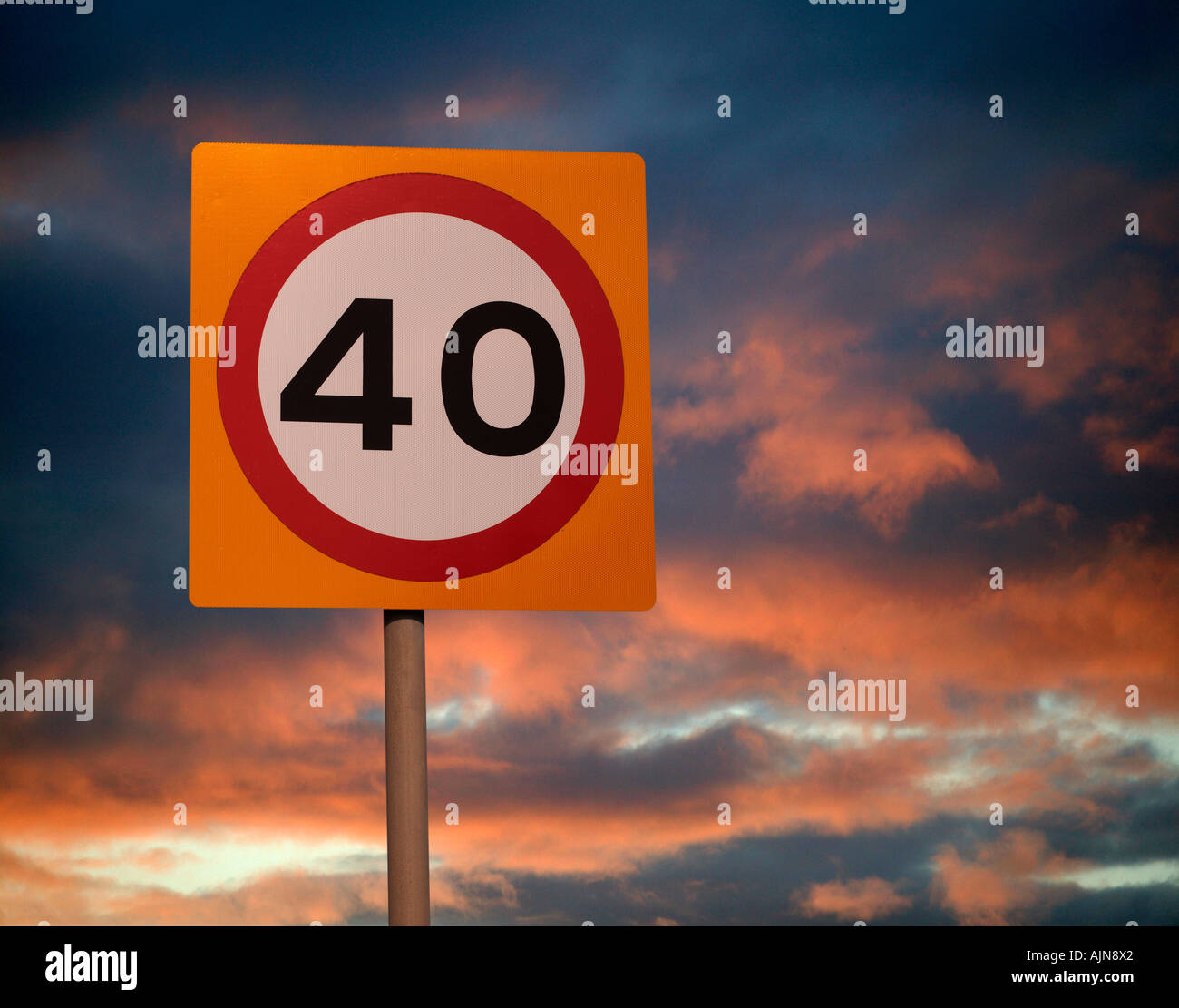 FORTY MILE AN HOUR ROAD SPEED LIMIT SIGN WITH TWILIGHT SKY BACKGROUND - Stock Image