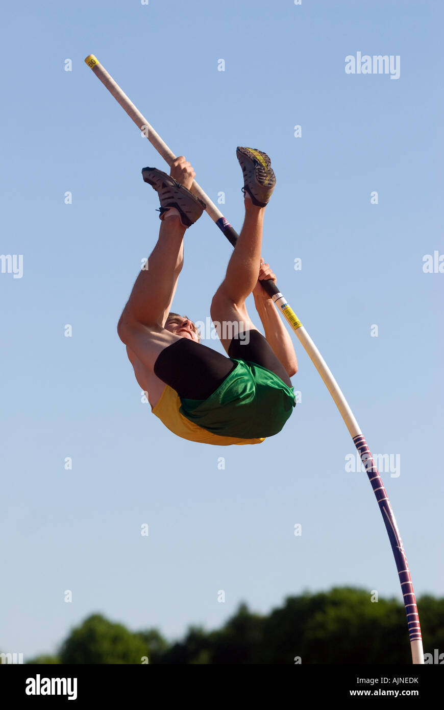 Pole vaulter during a high school track meet in the USA - Stock Image