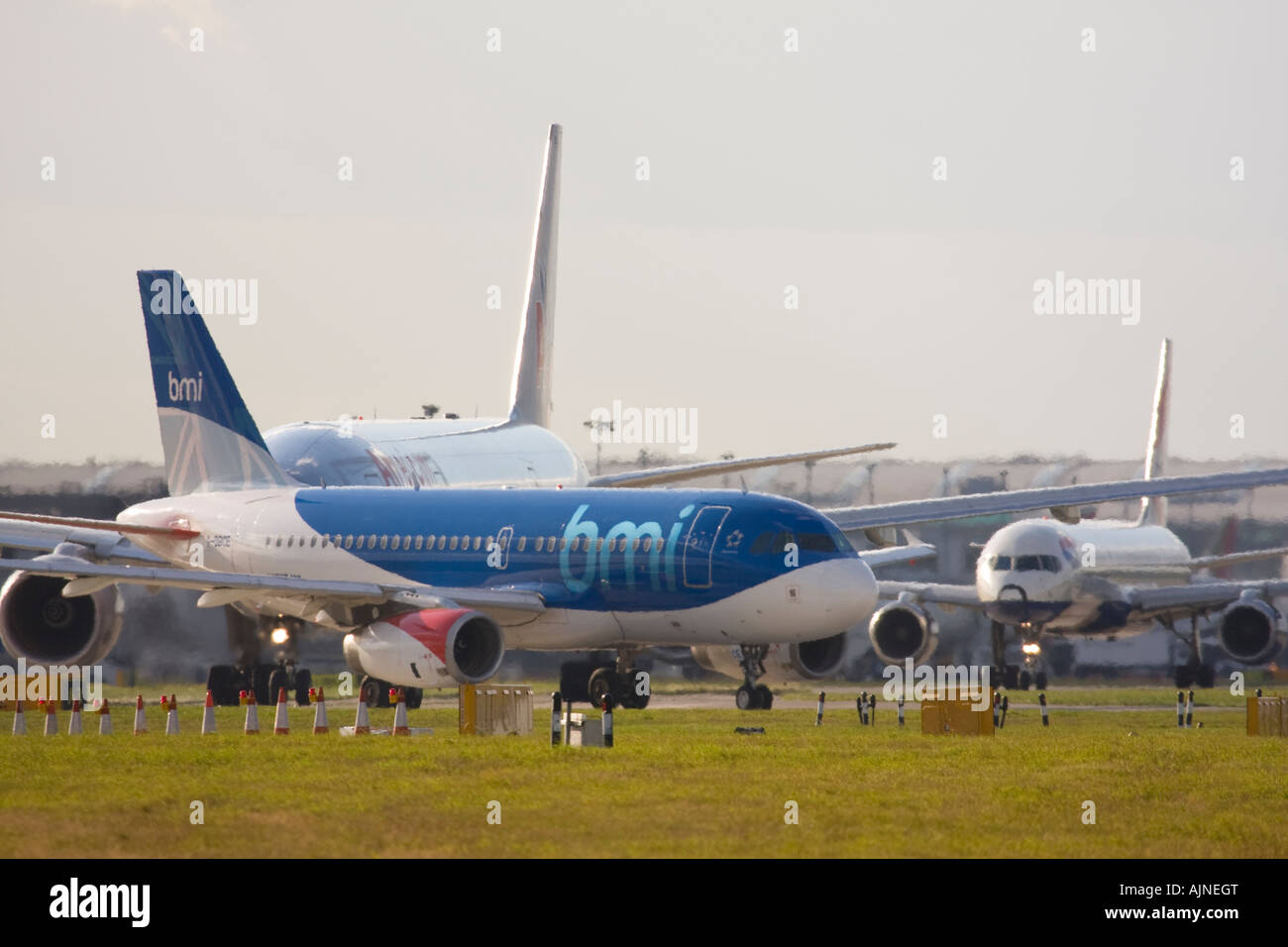 Airliners taxiing for departure at London Heathrow Airport, UK - Stock Image