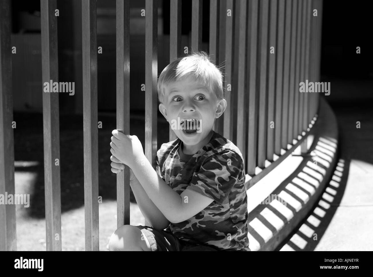 Child looking excited at a Zoo as he sees animals - Stock Image