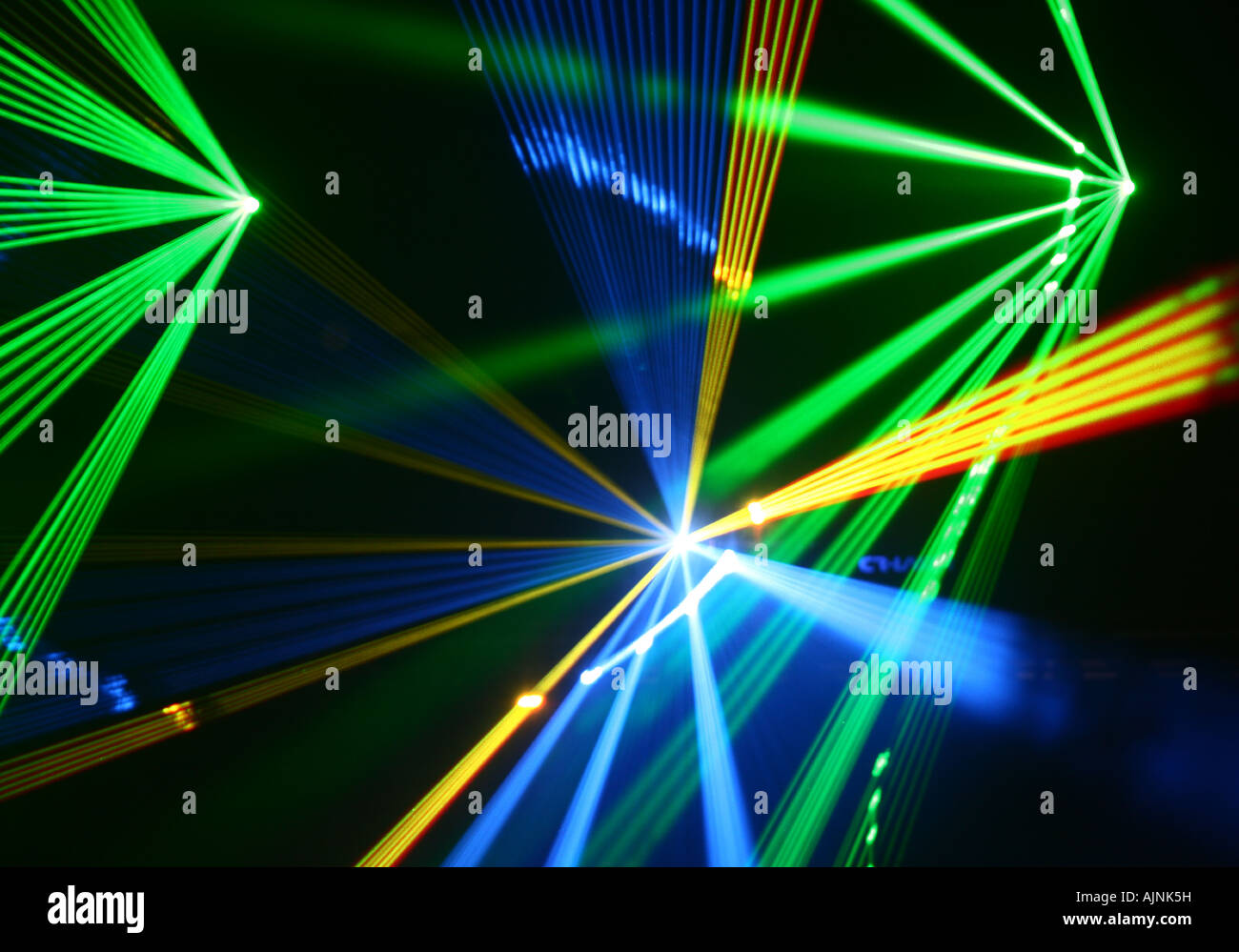 Green blue and yellow laser light show - Stock Image