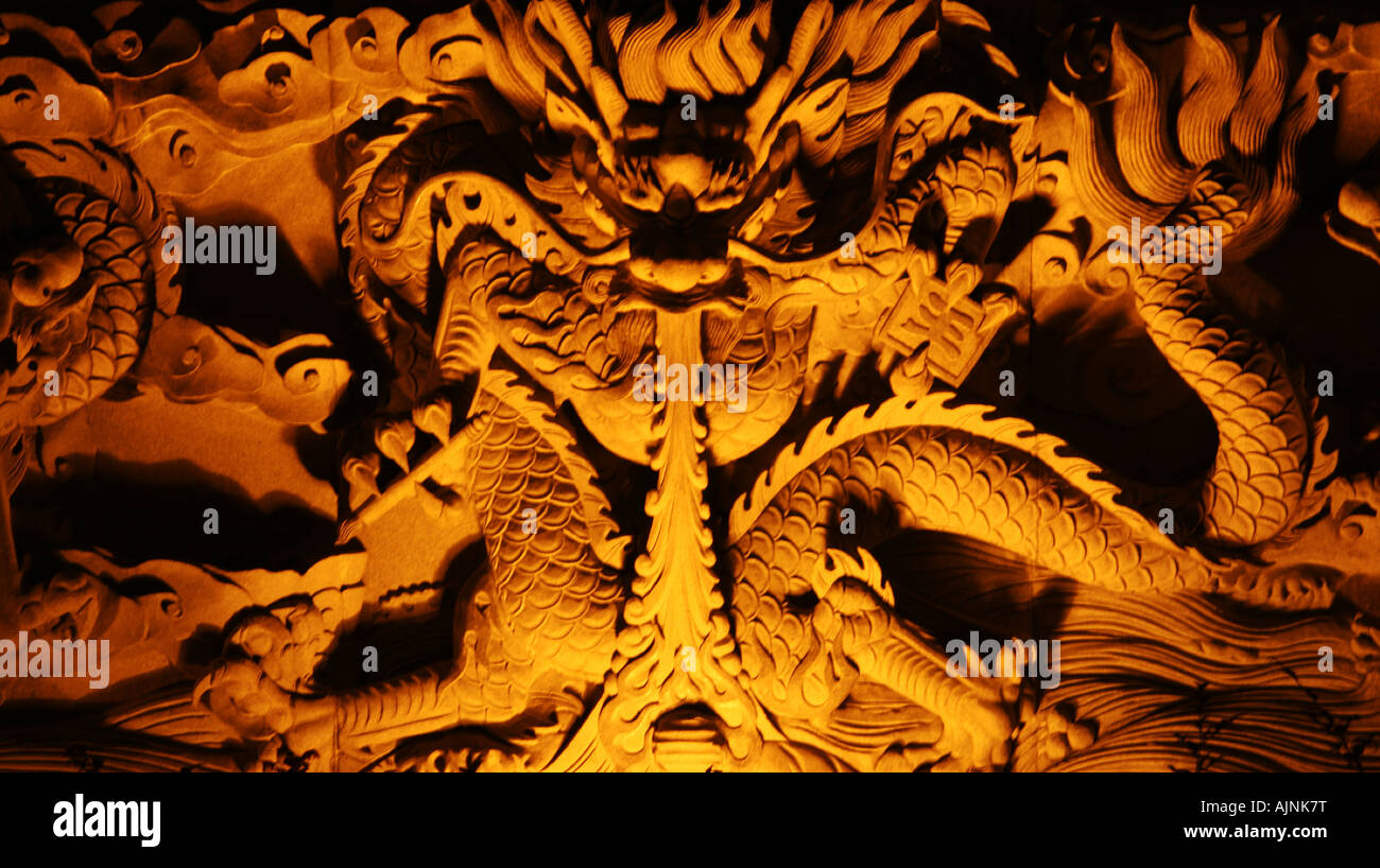Images of chinese dragons carved into wall hong kong Stock Photo